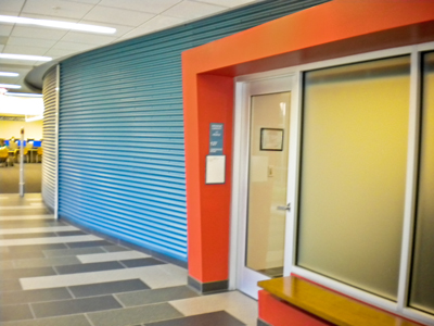 Cor-Pan corrugated metal wall panel from IMETCO creates a dynamic entry way for this public library